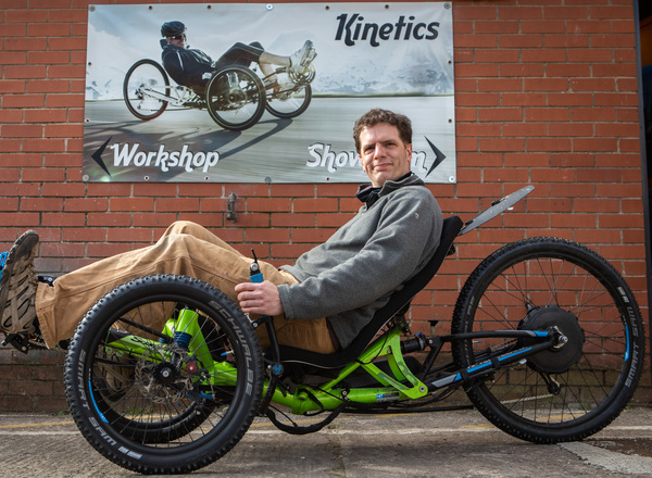 Queens Cross Workspace tenant Ben Cooper demonstrates one of his specialised bikes.